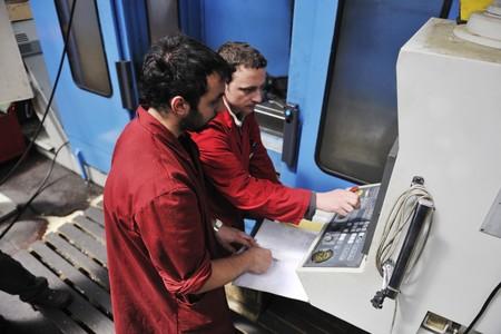 engineering people manofacturing industry with big modern computer mashines photo