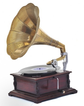 retro old gramophone for playing music over plates  isolated on white in studio photo