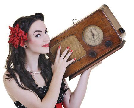 pretty girl listening music on radio isolated on white in studio photo
