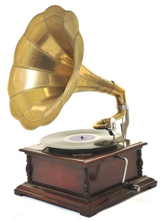 phonograph: retro old gramophone with horn speaker  for playing music over plates  isolated on white in studio