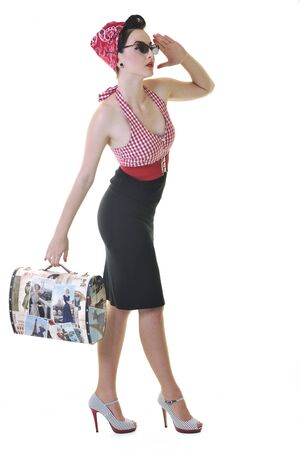 pretty young happy woman with travel bag waiting and posing isolated on white in studio Stock Photo - 7161475