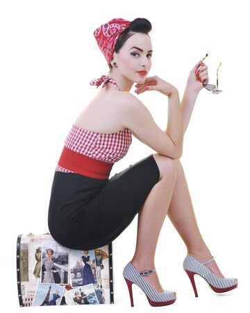 luggage: pretty young happy woman with travel bag waiting and posing isolated on white in studio