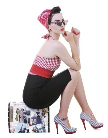 pretty young happy woman with travel bag waiting and posing isolated on white in studio photo