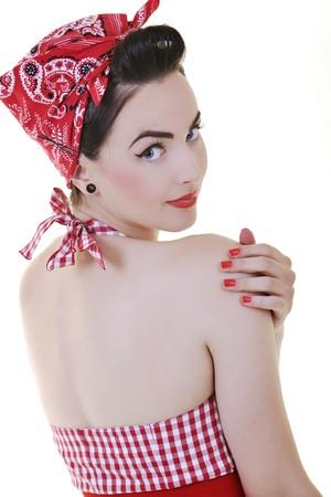 pin up vintage: bella donna giovane isolata on white in studio di vecchi abiti di moda che rappresenta lo stile retr� e pinup