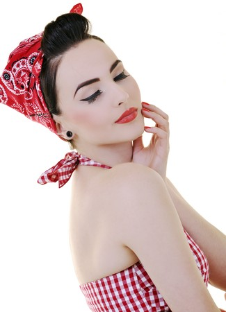 beautiful young woman isolated on white in studio in old fashion clothes representing pinup and retro style photo