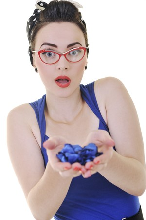 ins: pretty young woman with red eyeglassess hold blue flower petals ins hands isolated on white Stock Photo