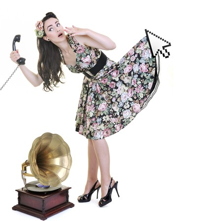 pretty young woman talking by old phone and mouse cursor arrow is holding her skirt Stock Photo - 7161613