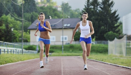 young girl morning run and competition on athletic race track Stock Photo - 7205049