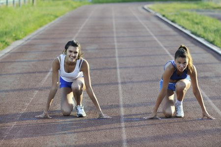 young girl morning run and competition on athletic race track Stock Photo - 7205123