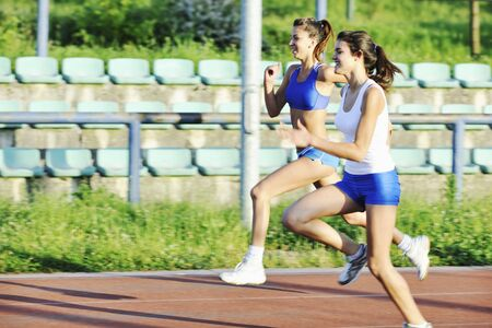 young girl morning run and competition on athletic race track Stock Photo - 7205039