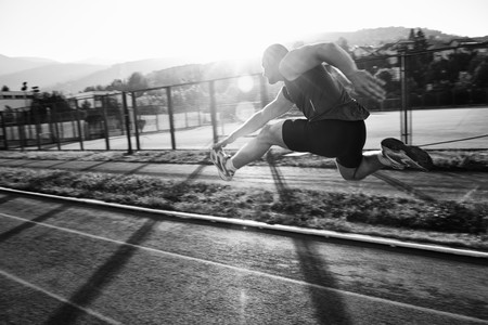 young healthy man run on athletic race sport track and representing concept of sort and speed Stock Photo - 7205129