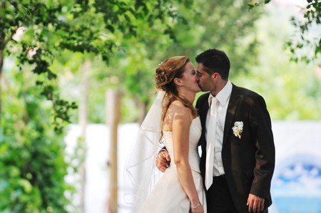 happy young and beautiful bride and groom at wedding party  outdoor photo