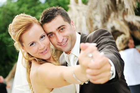 happy young and beautiful bride and groom at wedding party  outdoor Stock Photo - 7204996