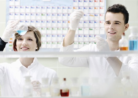 young students couple making test in bright labaratory photo