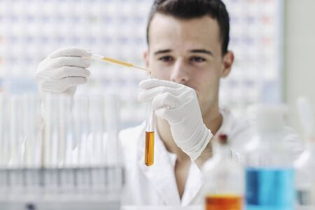 young man scientist in chemistry bright lab Stock Photo - 8108129