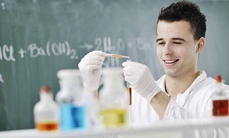 young man scientist in chemistry bright lab Stock Photo - 8109603