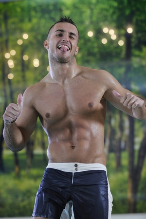 young healthy good looking macho man model athlete at hotel indoor pool Stock Photo - 7286126
