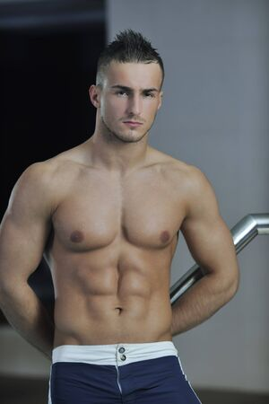 young healthy good looking macho man model athlete at hotel indoor pool Stock Photo - 7221210