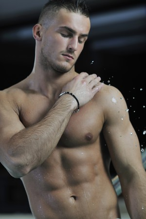 young healthy good looking macho man model athlete at hotel indoor pool Stock Photo - 7329009