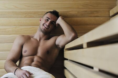 happy good looking and attractive young man with muscular body  relaxing in sauna hot Stock Photo - 7329070