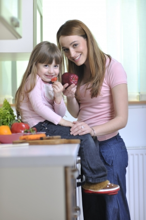 children breakfast: happy young family have lunch time with fresh fruits and vegetable food in bright kitchen