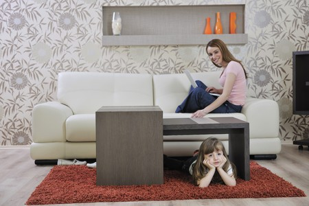 home furniture: happy youg family relaxing in modern livingroom at home