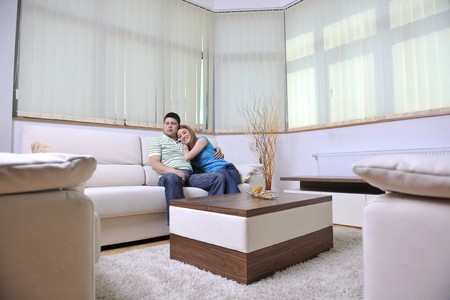 happy young couple relax at home in modern and bright living room Stock Photo - 13340239