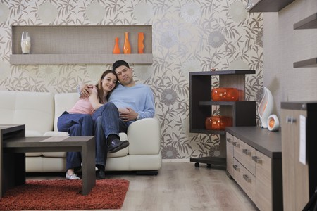 happy young couple relax at home in modern and bright living room photo