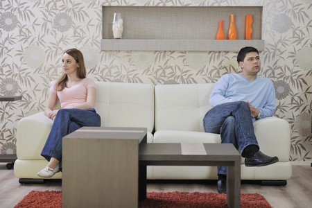 sitting room: happy young couple relax at home in modern and bright living room
