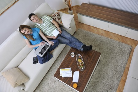 young couple at home with  modern livingroom indoor working on laptop on house finance and planing Stock Photo - 7850959