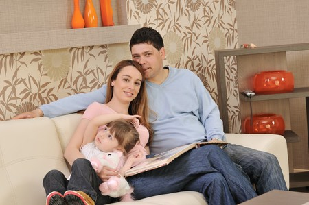 happy youg family relaxing in modern livingroom at home Stock Photo - 7822624