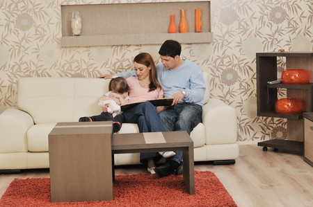 happy youg family relaxing in modern livingroom at home photo