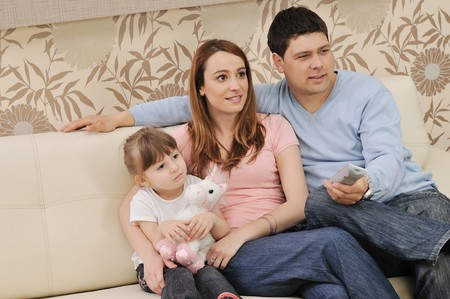 happy youg family relaxing in modern livingroom at home Stock Photo - 7822623