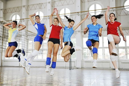 woman sport: volleyball game sport with group of young beautiful  girls indoor in sport arena Stock Photo