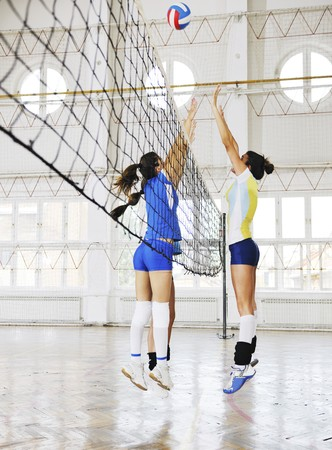 games hand: volleyball game sport with group of young beautiful  girls indoor in sport arena Stock Photo