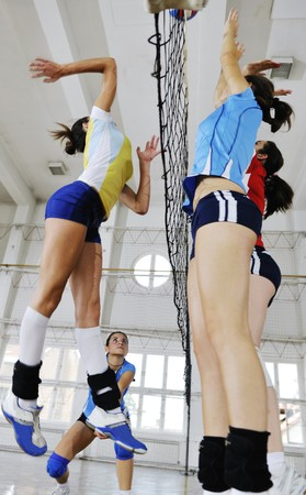 volleyball game sport with group of young beautiful  girls indoor in sport arena Stock Photo - 7840974