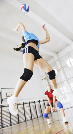 volleyball game sport with group of young beautiful  girls indoor in sport arena Stock Photo - 7614762