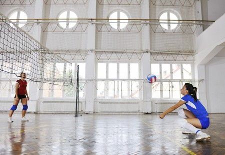 volleyball game sport with group of young beautiful  girls indoor in sport arena Stock Photo - 7956063