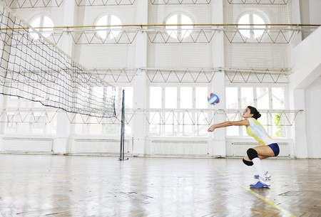 volleyball game sport with group of young beautiful  girls indoor in sport arena Stock Photo - 7956067