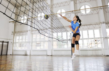 volleyball game sport with group of young beautiful  girls indoor in sport arena Stock Photo - 7956053