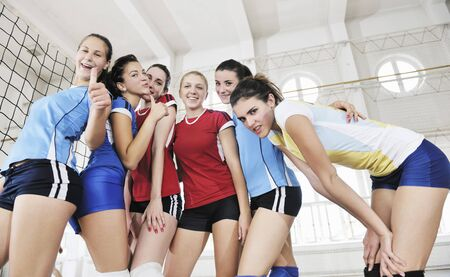volleyball game sport with group of young beautiful  girls indoor in sport arena Stock Photo - 7956050
