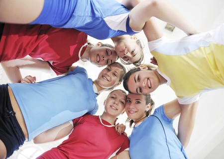 volleyball game sport with group of young beautiful  girls indoor in sport arena Stock Photo - 7956065