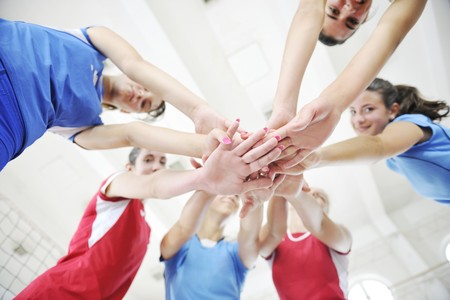 volleyball game sport with group of young beautiful  girls indoor in sport arena Stock Photo - 7822504