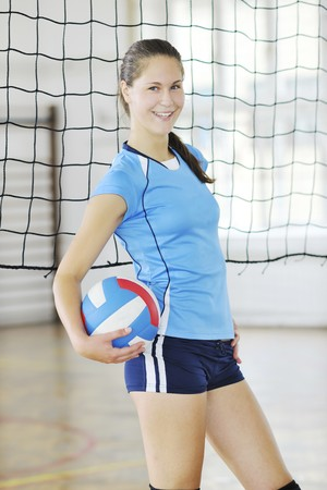 volleyball game sport with group of young beautiful  girls indoor in sport arena Stock Photo - 7614989