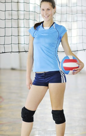 volleyball game sport with group of young beautiful  girls indoor in sport arena Stock Photo - 7614832