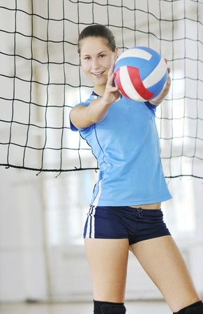 volleyball game sport with group of young beautiful  girls indoor in sport arena Stock Photo - 7614864