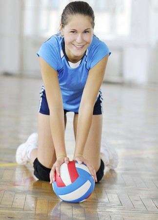 volleyball game sport with group of young beautiful  girls indoor in sport arena Stock Photo - 7829372