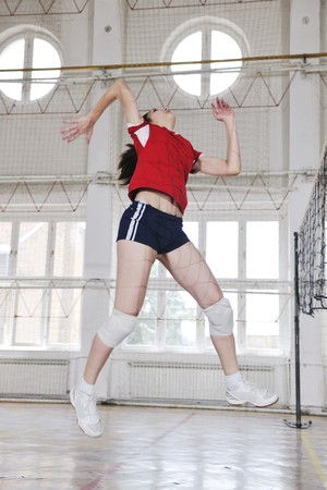volleyball game sport with group of young beautiful  girls indoor in sport arena Stock Photo - 7829396
