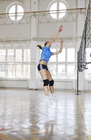 volleyball game sport with group of young beautiful  girls indoor in sport arena photo