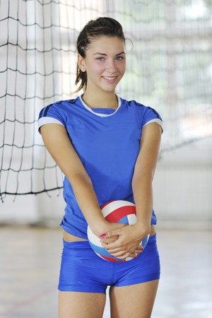girl action: volleyball game sport with group of young beautiful  girls indoor in sport arena Stock Photo
